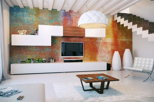 Lots of space, simple furnishings, a colorful feature wall, and plain floor - all part of a modern trend.